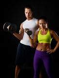 Couple doing dumbbell lifts Stock Images