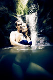 Couple Doing Embracing Under Waterfall Stock Photography