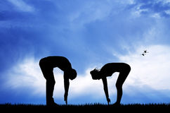 Couple doing exercises at dawn Royalty Free Stock Images