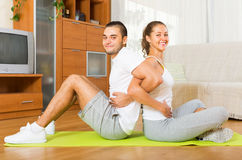 Couple doing  exercises together at home Royalty Free Stock Images
