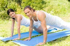 Couple doing fitness exercises Royalty Free Stock Image