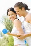 Couple doing fitness exercises Stock Image