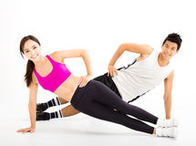 Couple doing fitness exercises on the white background Stock Images