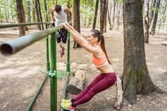 Couple doing full fitness workout in outdoor gym Royalty Free Stock Photo