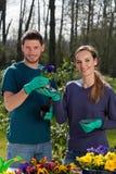 Couple doing garden work Stock Photos