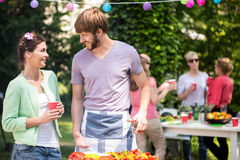 Couple doing grill party. Young couple doing grill party in the garden Royalty Free Stock Photos