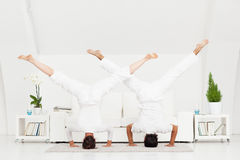 Couple Doing Headstand Stock Images