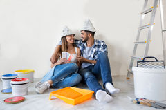 Couple doing home renovations. Choosing colors and enjoy in new apartment royalty free stock photos