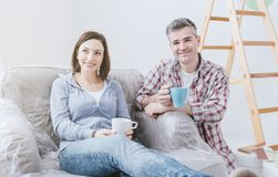 Couple doing home renovations stock images