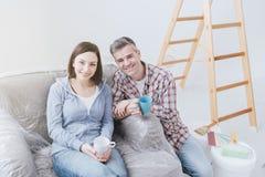 Couple doing home renovations stock photos