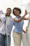 Couple Doing Household Chores Stock Photo