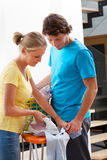 Couple doing the ironing Stock Images