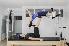 Couple doing pilates in cadillac. Royalty Free Stock Images