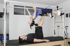 Couple doing pilates in cadillac. Royalty Free Stock Image