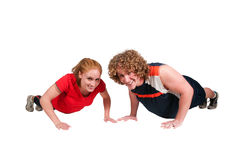 Couple doing pushups Royalty Free Stock Images