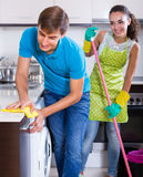 Couple doing regular clean up indoors Stock Photography