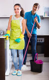 Couple doing regular clean up indoors Stock Image