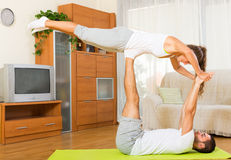 Couple doing regular exercises together Royalty Free Stock Photos