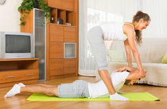 Couple doing regular exercises together Stock Images