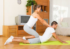 Couple doing regular exercises together Royalty Free Stock Photo