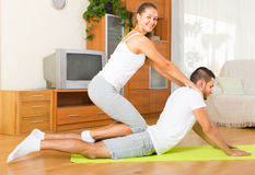 Couple doing regular exercises together Stock Photo