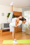 Couple doing regular exercises together Royalty Free Stock Images