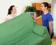 Couple doing relocation of furniture Stock Photo
