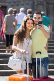 Couple doing selfie at the street Stock Images