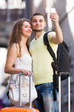 Couple doing selfie at the street Stock Photos