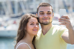 Couple doing selfie at the street Stock Photo