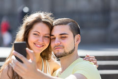 Couple doing selfie at the street Royalty Free Stock Photography