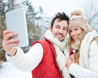 Couple doing selfies with tablet computer Royalty Free Stock Image