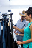 Couple doing shopping at clothes store. Happy couple doing shopping at clothes store Stock Photography