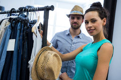 Couple doing shopping at clothes store. Portrait of couple doing shopping at clothes store Royalty Free Stock Photos