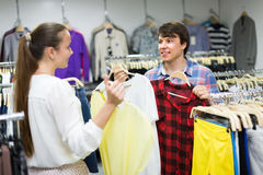 Couple doing shopping at the clothing store Stock Images