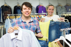 Couple doing shopping at the clothing store Royalty Free Stock Photo