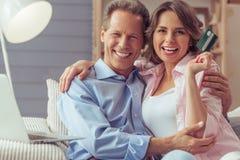 Couple doing shopping online Stock Photo