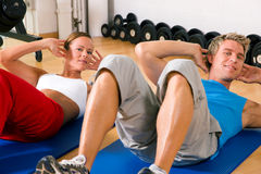 Couple doing Sit-ups Stock Photography