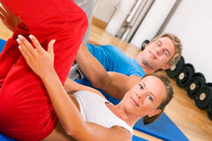 Couple doing Sit-ups Stock Images