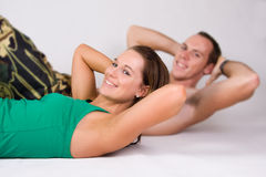 Couple doing sit ups Royalty Free Stock Image