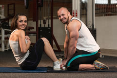 Couple Doing Sit-Ups Abdominal Crunch Stock Images