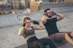 Couple doing sit ups stock image