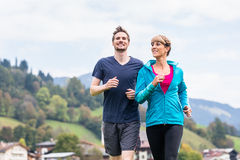 Couple doing sport in the mountains Royalty Free Stock Image