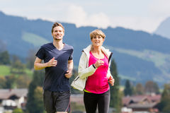 Couple doing sport in the mountains Royalty Free Stock Photo