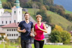 Couple doing sport in the mountains Stock Photos