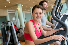 Couple doing sports in a fitness club Stock Photo