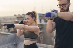 Couple doing straight punches exercise stock image