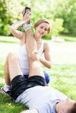 Couple doing stretching exercises in park Royalty Free Stock Photo