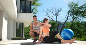 Couple Doing Stretching Exercises Together in front of luxury vi Stock Images