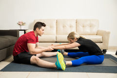 Couple doing stretching exercises together Royalty Free Stock Photos
